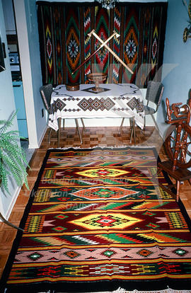 A dining room decorated with woven carpets