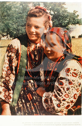 A girl and a young woman in festive costumes. Stanislav region.