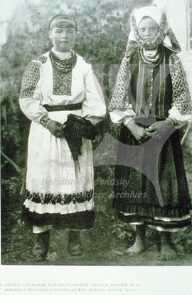 A girl and a young woman in summer costumes. Polissia. Early XXth century.