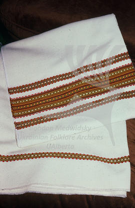 Woven fabric with embroidery on it